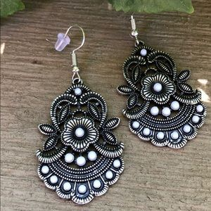 Antiqued silver toned earrings that absolutely WOW